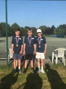 Arthur, Jack and Bobby posing with medals won at the Lionel Cox Tournament