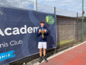 18 and Under Boys County Champion Seb Muller holding the trophy