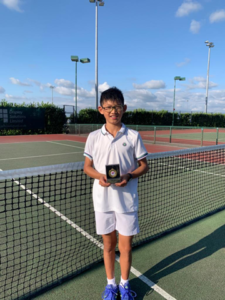11and Under Consolation winner Bryan Goh